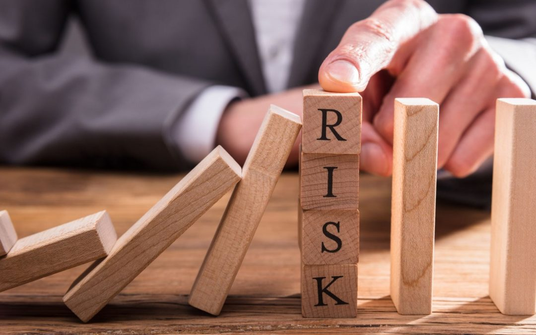 image of a tower of blocks that spells risk
